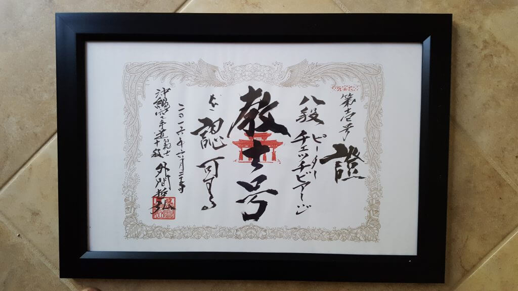 Dyplom 8 Dan nadany przez Hanshi Tetsuhiro Hokama